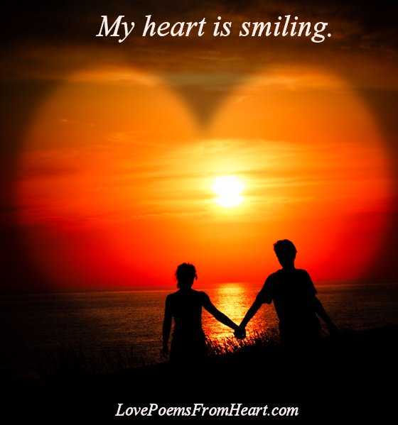 Heart smiling - Couple at sunset